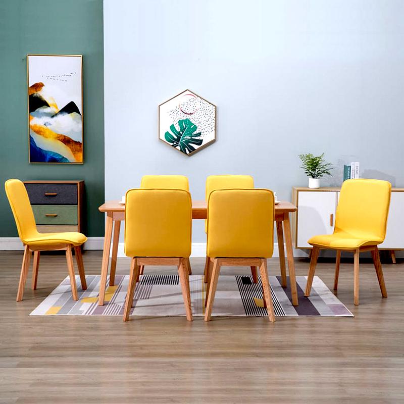 ładne, żółte krzesła do salonu lub jadalni